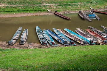 Thailand,Many punt boats on the river bank.