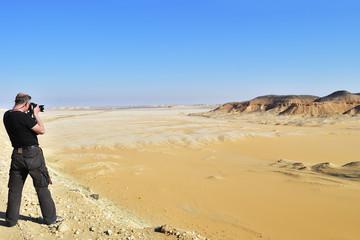 Tourist in Sahara desert. Egypt