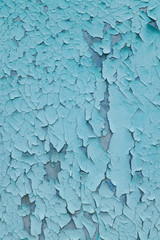 background consisting of old blue green door with peeling paint