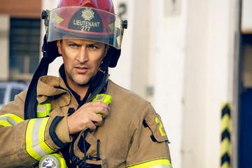 Firefighter talking on radio on emergency scene