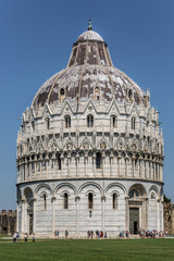 Tourists at the famous Pisa Baptistery of St. John, a Roman Catholic ecclesiastical building in Pisa, Italy.