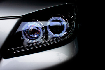 Car headlights of silver color dark tone is aggressive and gorgeous.