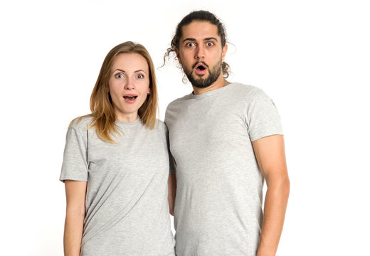 Wow, surprised! Portrait of surprise couple on white background. Couple man and woman looking at camera.
