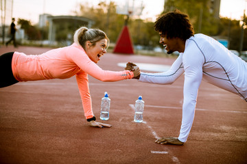Woman training with personal trainer outdoor