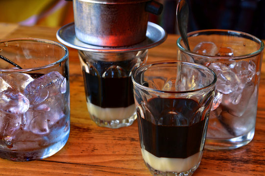 Traditional Vietnamese ice coffee set. Condensed milk at the bottom, strong coffee and ice cubes. Da Lat, Vietnam,