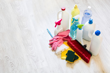 Cleaning products on white floor. Copyspace