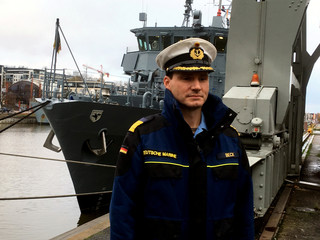 German navy Captain Beck poses for a picture in Turku