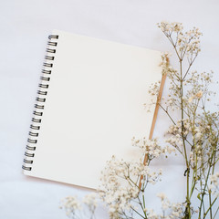 flower with blank notebook for background
