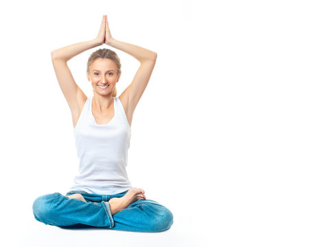 Young healthy woman doing yoga exercises, isolated on white background