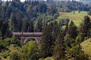 A picturesque Alpine landscape with an old railway bridge. Austria.
