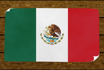 Illustration of a Mexican flag painted on the papier pasted on the woody wall