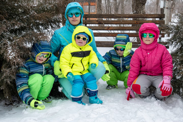 bdad2880071 Happy young mother in blue ski suit wearing sunglasses with funny ...