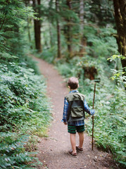 little boy hiking in nature
