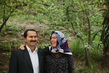 Middle aged Turkish couple show happiness and affection.