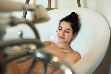 Smiling woman in bath.
