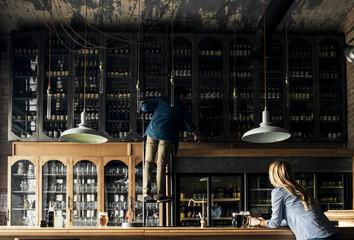 Barmen Working at Bar
