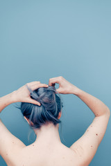 Delicate Young Woman With Pale Skin and Blue Dyed Hair