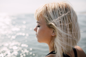 Portrait of a beautiful blonde woman on the beach