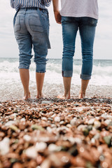 Couple standing together in the shallow sea water