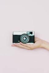Hand holding a retro camera
