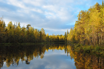 Early autumn on the forest lake.