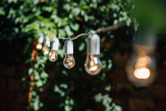 Light bulb decor in outdoor party. Party