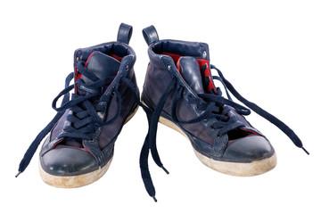Old worn blue boy shoes.