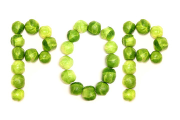 The word 'pop' is spelled out with brussel sprouts on a white background to provide a light hearted way of referencing some of the side effects of eating them, and green vegetables in general