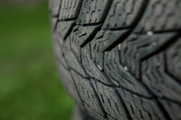 Winter tires close-up . Tires on green background
