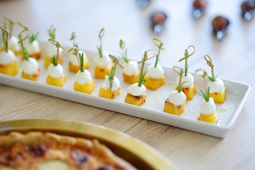Delicious baked pineapple and mozzarella snacks served on a party or wedding reception.