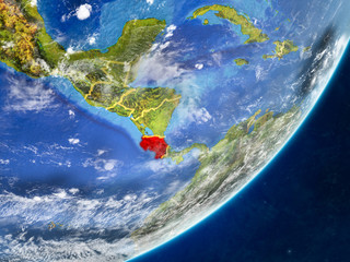 Costa Rica on model of planet Earth with country borders and very detailed planet surface and clouds.