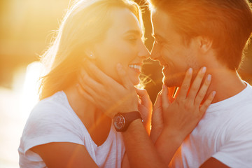 Couple in love enjoying moments during sunset