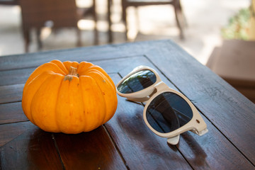 Sunglasses and Pumpkin Autumn Holiday Concept