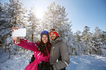 Couple on winter taking photo outdoor