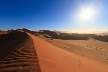 Red sand dunes in morning light at sunrise in the Namib desert in Sossusvlei, Namibia.