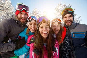 Friends having fun in winter nature