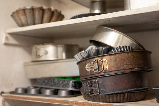 Old baking molds on an old kitchen table. Baking accessories in the kitchen.
