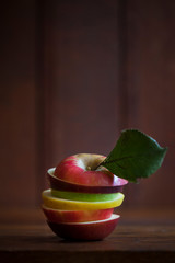 An apple made of slices from many varieties