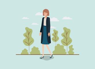 elegant businesswoman walking in the park
