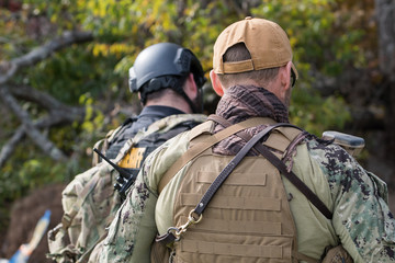 Two officers wearing tactical gear