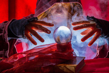 a fortune teller reads from a crystal ball