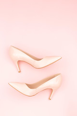 Nude shoes on the pink background