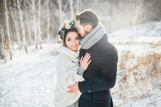 Wedding in winter. Snowy Sunny day.