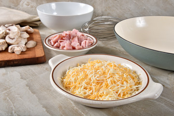Grated cheese with ham and mushrooms
