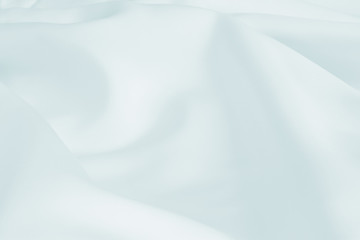 Abstract crumpled white light blue wedding background with silk, satin or cloth folds and drapes fabric texture. Luxury cloth,wavy grunge satin textured velvet material or luxurious Christmas holiday.