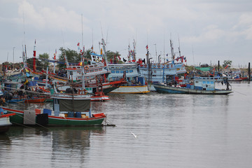 local fisherman boats park to the sea for fishing. Traditional colorful asian fishing boats in fishing village