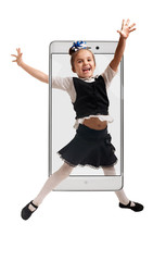 Portrait of cheerful excited school girl jumping with raised hands, concept virtual reality of the smartphone. going out of the device