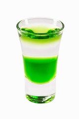 Closeup glass of green fairy layered cocktail shot with absinthe isolated at white background.