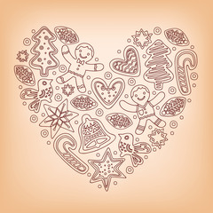 Christmas baking concept. Heart shape formed by various gingerbread figures featuring candy canes, christmas trees, holly, stars, bells, doves and hearts.