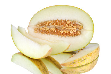 Half melon with seeds and melon slices on white mirror background with reflection isolated close